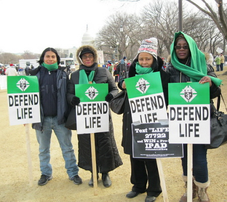 African Americans and Latinos with 'Defend Life' signs