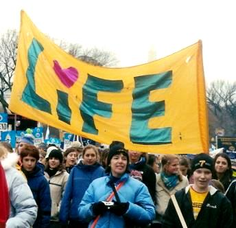 Marchers with LIFE banner