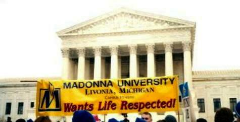 Madonna University students with their banner at the Supreme Court