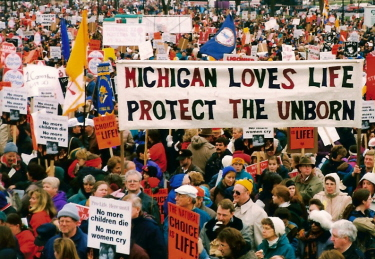 Banner: 'Michigan Loves Life/Protect the Unborn'