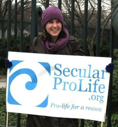 Young woman with sign for SecularProLife.org