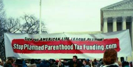 Banner on Capitol Hill calls for end to tax funding of Planned Parenthood